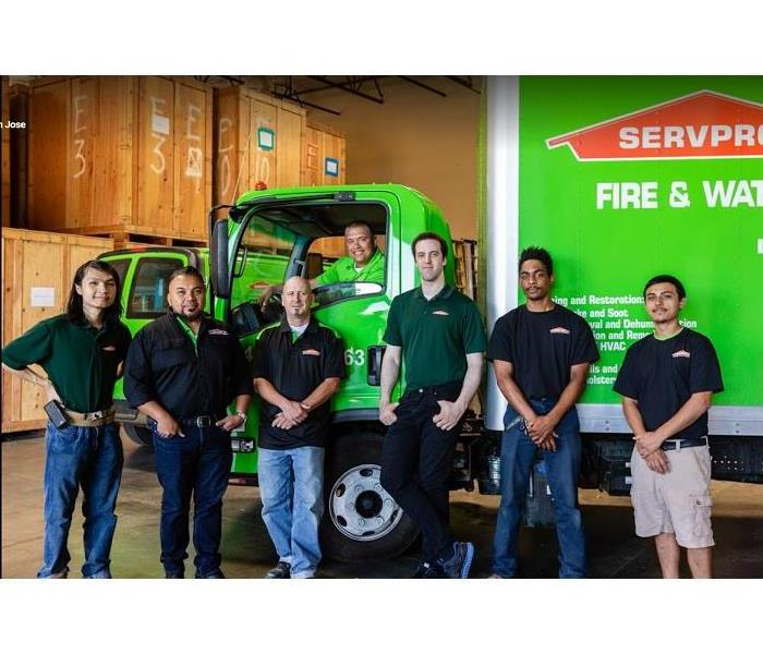 SERVPRO team members standing in front of SERVPRO truck
